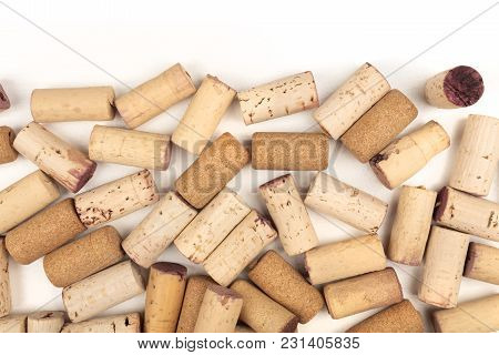 Many Wine Corks On A White Background With A Place For Text. A Design Template For A Tasting Invitat