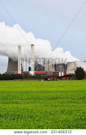 Industrial Buildings Polluting Air With Cogeneration Plant Blowing Smoke Out Of Its Chimneys