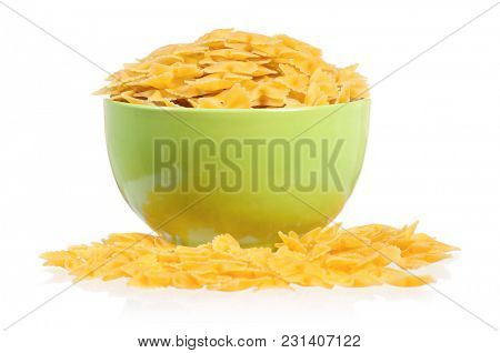 Raw pasta in green plate, isolated on white background