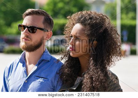 Young Multiracial Couple Look Serious And Frightened As Diversity Friendship And Togetherness Concep