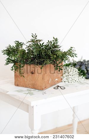 Box With Flowers To Create A Bouquet On The Table