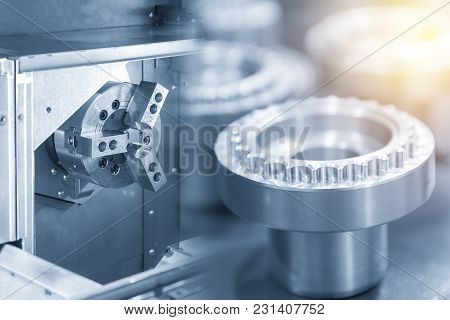 The Cnc Lathe Machine Making The Screw Thread Shaft Parts In Light Blue Scene.