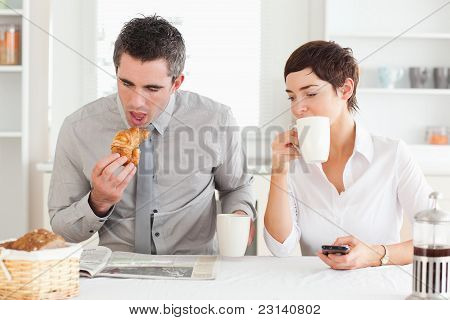 Cheerful Couple Having Breakfast Together