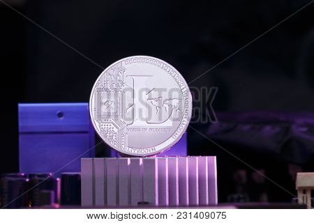 Image litecoin and processor on pink background