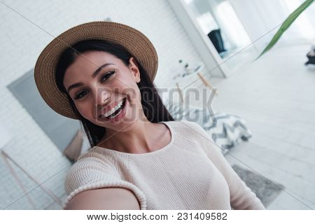 Funky Selfie. Beautiful Young Woman Looking At Camera With Smile And Making Selfie While Standing In