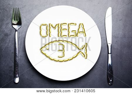 Omega 3 From Salmon Oil Capsules On White Plate With Fish Shape