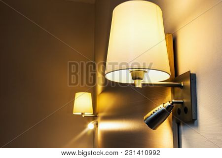 Floor Lamp On The Wall Above The Bed In The Room Or Hotel Room