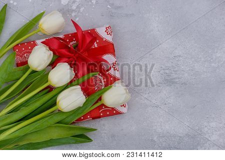 Bouquet White Tulips And Red Gift Box On Stone Background