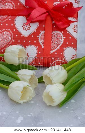 Beautiful Tulips And Gift Box On Gray Stone Background