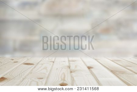 Background Image: Wooden Countertop On Blurred Stone Wall Background. Can Be Used For Display Or Ins