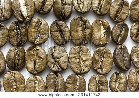 Roasted Coffee Beans. Different Shapes And Different Shades Of Brown. On A White Background. Photo F
