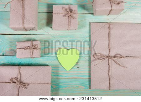 Gift Boxes Wrapped Kraft Paper Tied With Twine And Sticker Heart And Tied With Twine. With Copy Spac
