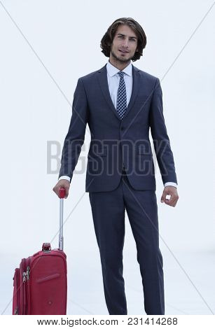 portrait of young businessman with suitcase