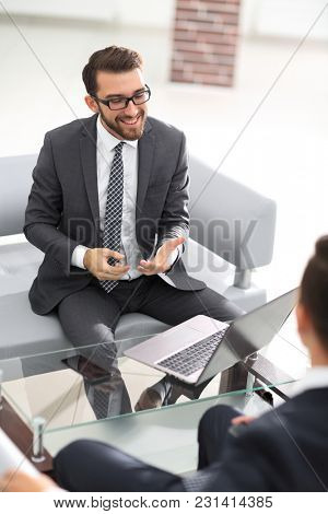 Two handsome businessmen in office
