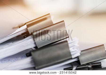 Stack Of Paper Documents With Clip, Pile Of Unfinished Documents On Office Desk Folders. Business Pa
