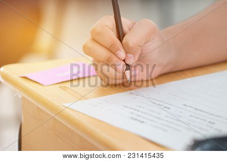 Education Test Concept : Hands Student Holding Pen For Testing Exams Writing Answer Sheet Or Exercis