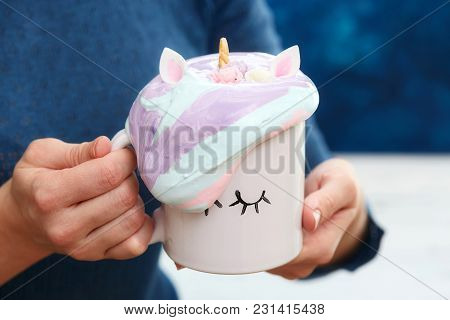 Mug In Woman Hands With Colorful Cream In Shape Of Hair