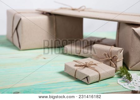 Gift Boxes Wrapped Kraft Paper Tied With Twine And Paper Snowflake And Tied With Twine. With Copy Sp
