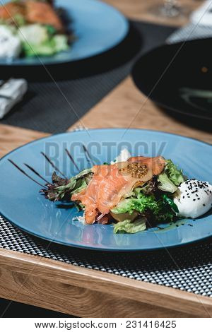 Delicious Salmon Salad With Egg In A Restaurant At The Food And Wine Pairing. Small Portion On A Blu