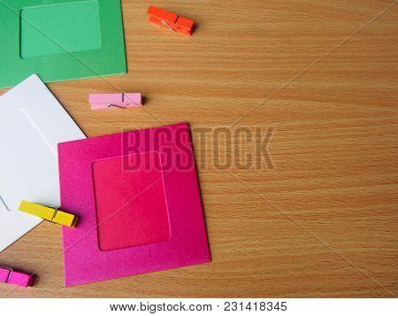 Colorful Wooden Pegs With Colorful Picture Frame On Wooden Table