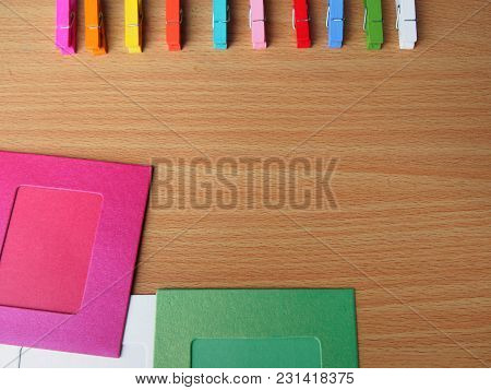 Blur Background - Row Of Colorful Wooden Pegs With Colorful Picture Frame On Wooden Table