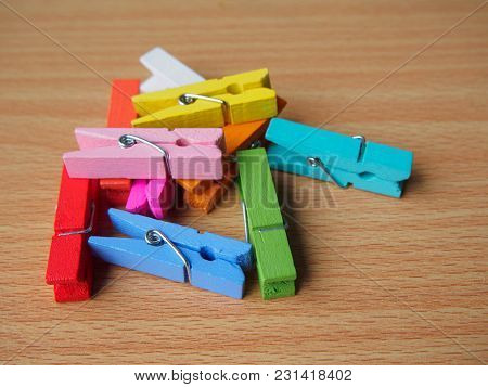 Closeup Colorful Wooden Pegs On Wooden Table