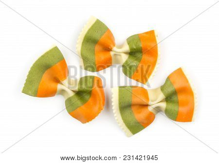 Farfalle Pasta With Green Spinach And Orange Carrot Isolated On White Background Top View Three Raw