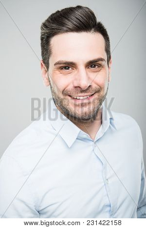 Portrait Of Handsome Architect Wearing Shirt And Smiling