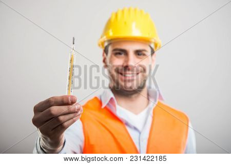 Selective Focus Of Handsome Architect Holding Thermometer