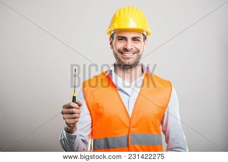 Portrait Of Handsome Architect Holding One Screwdriver