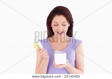 Cute Woman Opening A Box