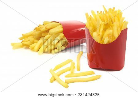 Group Of French Fries In A Red Carton Boxes In Close-up And Isolated On White Background.