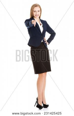 Beautiful caucasian business woman pointing on you. Isolated on white.