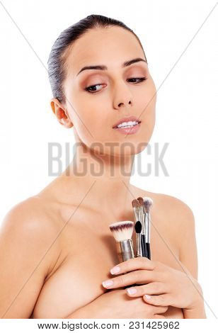 Beautiful girl with make-up brushes. Isolated on white background.
