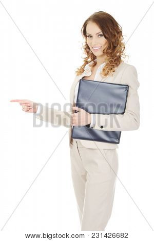 Smiling businesswoman pointing with clipboard.