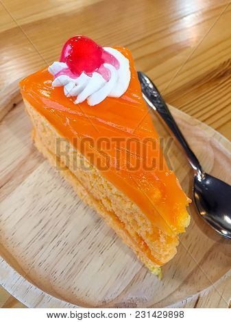 Orange Cake On Wood Table An Isolated