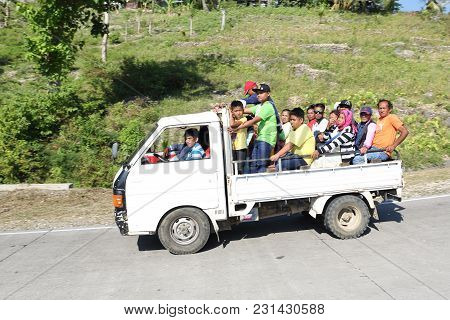 Dalaguete, Cebu / Philippines - February 10, 2018: Families With Many Members Are Driving From The M