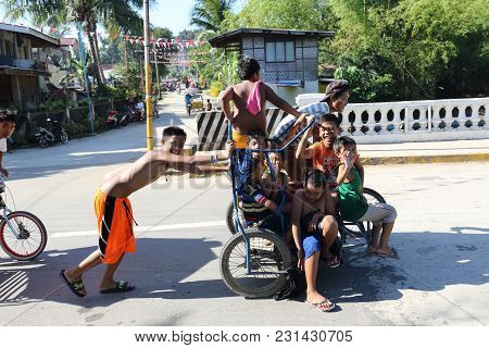 Dalaguete, Cebu / Philippines - February 10, 2018: A Lot Of Kids Have Fun While Riding On A Tricycle