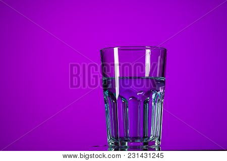 The Water In Glass On Lilac Background At Studio. Vivid Bright Colored Lighting. Trendy In 2018 Ultr