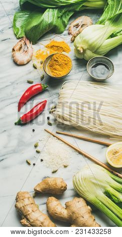 Asian Cuisine Ingredients Over Marble Background. Vegetables, Spices, Shrimp, Rice, Sauces For Cooki