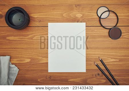 Photo Camera Accessory With Notepad On Table
