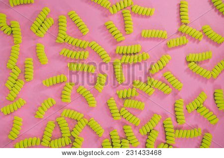 Top View Of Fusilli Pasta On The Bright Blue Green Background.