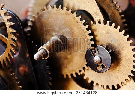 Cogs Wheels Machinery, Rusty Iron Mechanism. Black Metal Gears Close-up Photo. Shallow Depth Field.