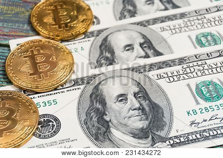 Bitcoin And Money On A Colored Wooden Background. Bitcoin Golden Coin New Virtual Money