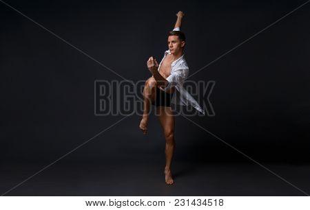 A Professional Dancer In Black Trousers, Dances