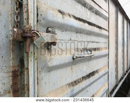 Old Key Lock On Rusty Freight Container Locked