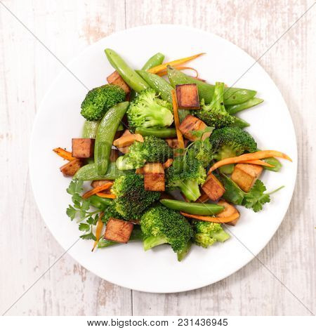 fried tofu and vegetable cooked with soya sauce