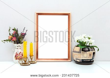 A4 Wooden Frame Mockup With Flowers And Candles. Vertical Orientation.