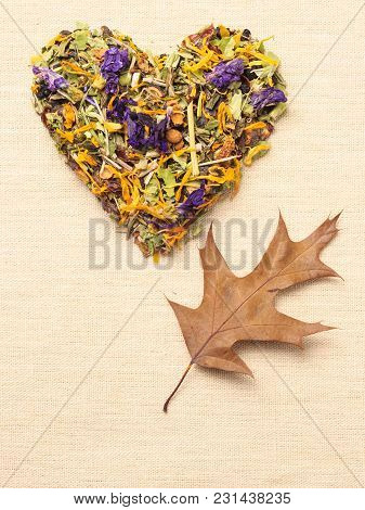 Dried Herb Leaves Heart Shaped On Burlap Surface. Herbaceous Dry Aromatic Plant. Healing Herbs Herba