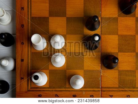 Old Chess On A Chess Classic Wooden Board On A Dark Background
